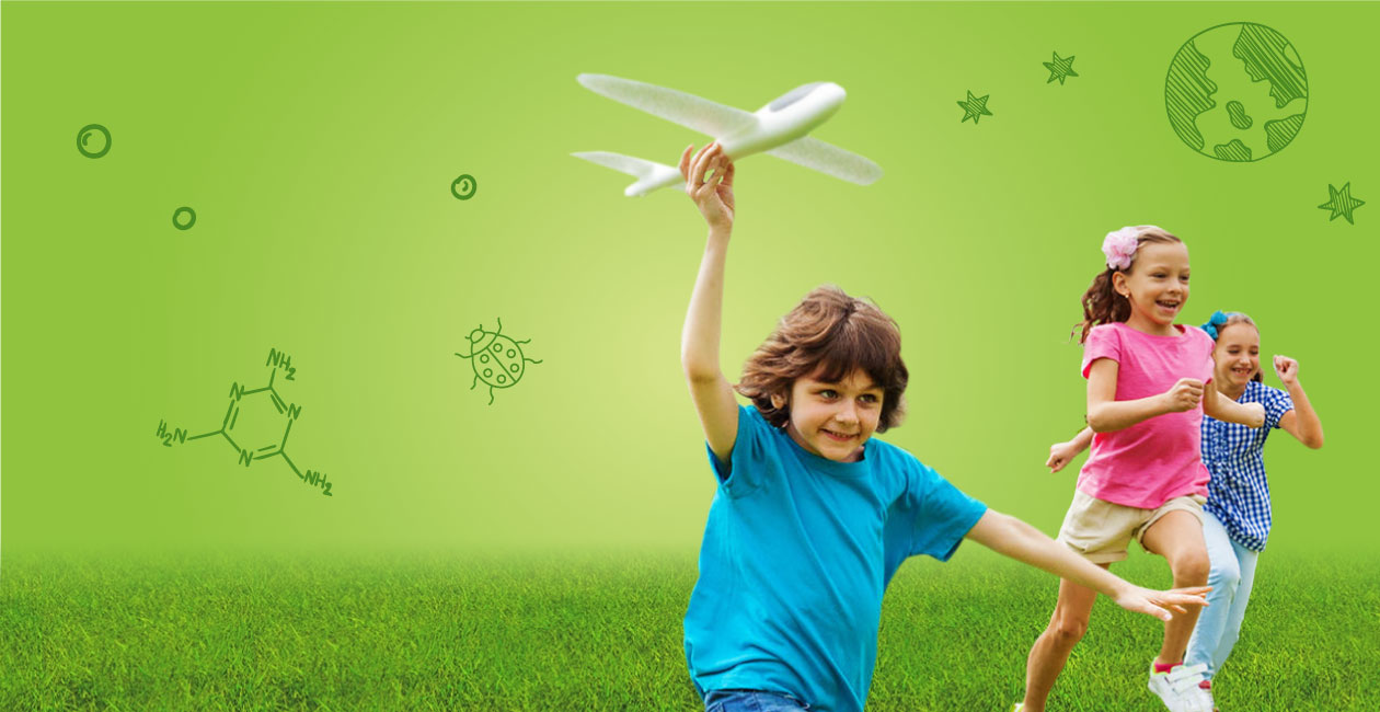 kid holding airplane and running with friends